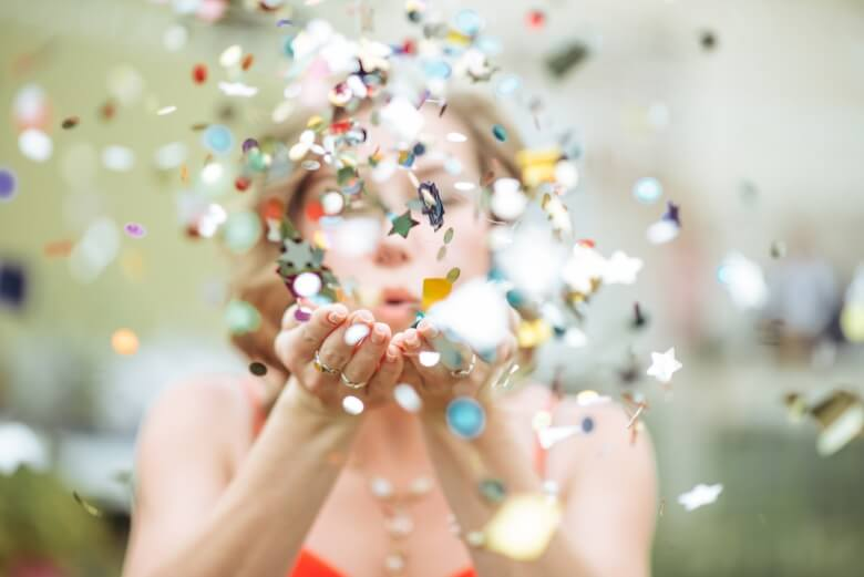 Girl-Blowing-Confetti
